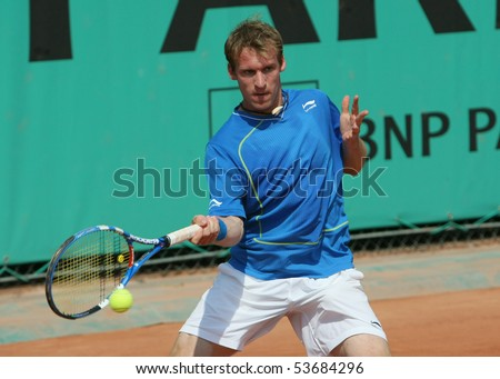 PARIS - MAY 21: Grega ZEMLJA of Slovenia in action at French Open, Roland Garros qualification 3rd round match on May 21, 2010 in Paris, France. - stock photo
