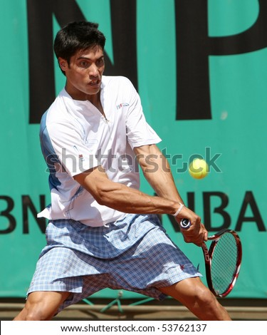PARIS - MAY 20: Guillermo ALCAIDE of Spain in action at French Open, Roland Garros qualification 2nd round match on May 20, 2010 in Paris, France. - stock photo