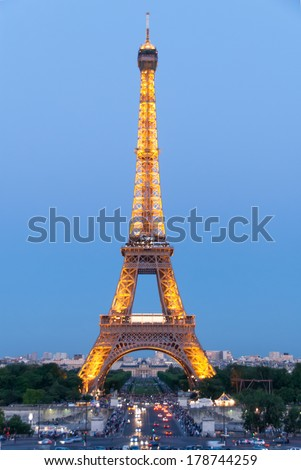 PARIS-MAY 30: Illuminated Eiffel Tower on May 30, 2009. As a top business and cultural center, Paris is one of the most visited cities in the world. - stock photo