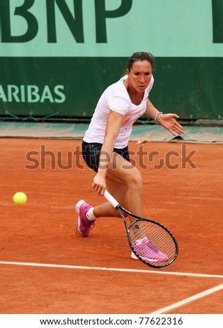 PARIS - MAY 20: Jelena JANKOVIC of Serbia during her practice at French Open, Roland Garros on May 20, 2011 in Paris, France. - stock photo