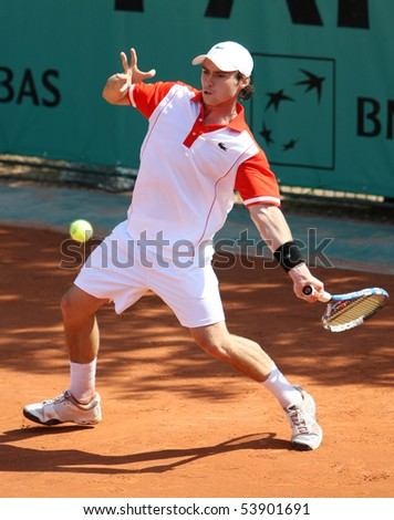 PARIS - MAY 20: Jonathan DASNIERES DE VEIGY of France in action at French Open, Roland Garros qualification 2nd round match on May 20, 2010 in Paris, France. - stock photo