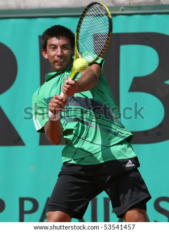 PARIS - MAY 20: Jorge Aguilar of Chile in action at French Open, Roland Garros qualification 2nd round match on May 20, 2010 in Paris, France. - stock photo