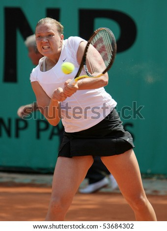 PARIS - MAY 21: Kaia KANEPI of Estonia plays the 3rd round qualification match at French Open, Roland Garros on May 21, 2010 in Paris, France. - stock photo
