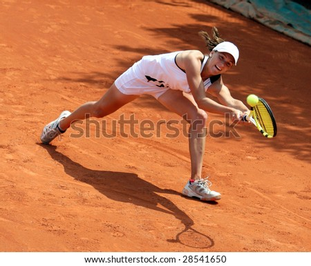 PARIS - MAY 21: Kazakhstan's professional tennis player YAROSLAVA SHVEDOVA during her match at French Open, Roland Garros on May 21, 2008 in Paris, France. - stock photo