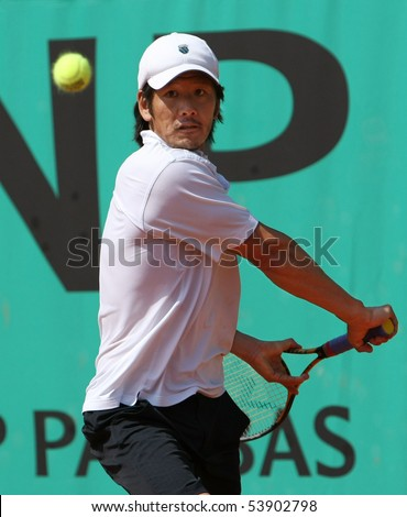 PARIS - MAY 21: Kevin KIM of USA in action at French Open, Roland Garros qualification 3rd round match on May 21, 2010 in Paris, France. - stock photo