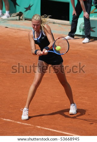 PARIS - MAY 22: Kristina MLADENOVIC of France plays the exhibition match at French Open, Roland Garros on May 22, 2010 in Paris, France. - stock photo