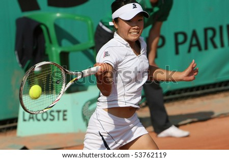 PARIS - MAY 21: Kurumi NARA of Japan plays the 3rd round qualification match at French Open, Roland Garros on May 21, 2010 in Paris, France. - stock photo