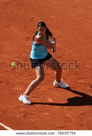 PARIS - MAY 23: Marion Bartoli of France plays the 1st round match at French Open, Roland Garros on May 23, 2011 in Paris, France. - stock photo