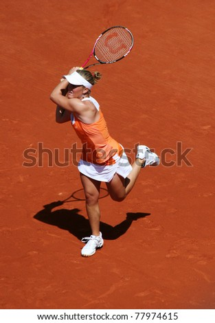 PARIS - MAY 23: Melanie Oudin of USA plays the 1st round match at French Open, Roland Garros on May 23, 2011 in Paris, France. - stock photo