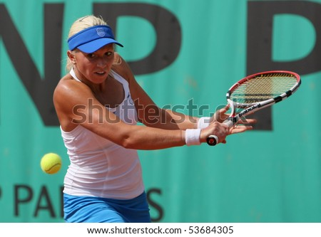 PARIS - MAY 21: Michaella KRAJICEK of Netherlands plays the 3rd round qualification match at French Open, Roland Garros on May 21, 2010 in Paris, France. - stock photo