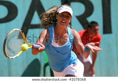PARIS - MAY 22: Michelle LARCHER DE BRITO of Portugal in action at French Open, Roland Garros on May 22, 2009 in Paris, France. - stock photo