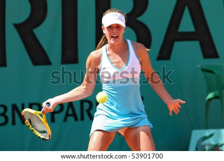 PARIS - MAY 20: Michelle LARCHER DE BRITO of Portugal plays the 2nd round qualification match at French Open, Roland Garros on May 20, 2010 in Paris, France. - stock photo