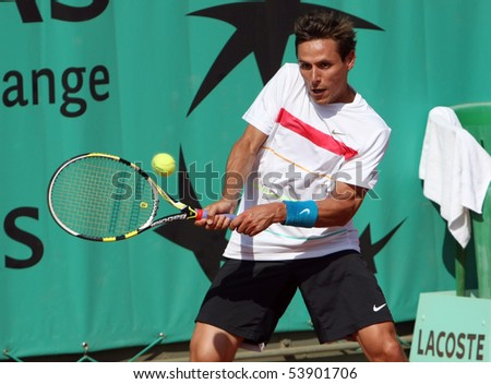 PARIS - MAY 20: Nicolas DEVILDER of France in action at French Open, Roland Garros qualification 2nd round match on May 20, 2010 in Paris, France. - stock photo