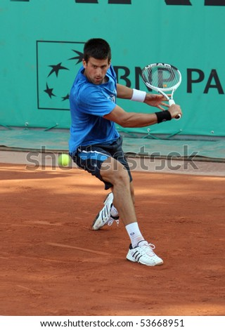 PARIS - MAY 22: Novak DJOKOVIC of Serbia during his practice at French Open, Roland Garros on May 22, 2010 in Paris, France. - stock photo