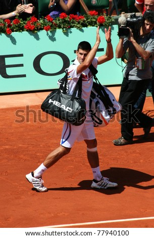 PARIS - MAY 23: Novak Djokovic of Serbia greets the public as he leaves the court after winning the 1st round match  at French Open, Roland Garros on May 23, 2011 in Paris, France. - stock photo