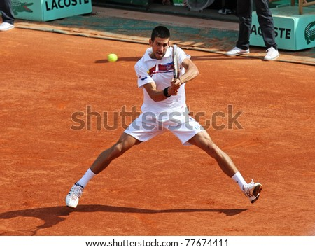PARIS - MAY 21: Novak Djokovic of Serbia plays the exhibition match  at French Open, Roland Garros on May 21, 2011 in Paris, France. - stock photo