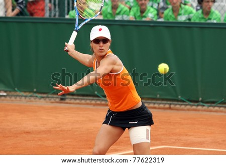 PARIS - MAY 20: Nuria Llagostera Vives of Spain plays the 3rd round qualification match at French Open, Roland Garros on May 20, 2011 in Paris, France. - stock photo