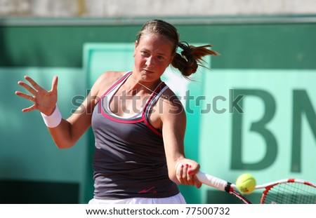 PARIS - MAY 18: Oksana KALASHNIKOVA of Georgia plays the 1st round qualification match at French Open, Roland Garros on May 18, 2011 in Paris, France. - stock photo
