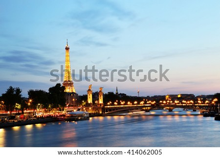 PARIS - May 29: Paris cityscape with Eiffel Tower at dusk on May 29, 2015 in Chicago. Erected in 1889 as the entrance arch to the 1889 World's Fair, it has become a global cultural icon of France. - stock photo
