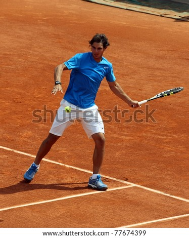 PARIS - MAY 21: Rafael Nadal of Spain plays the exhibition match  at French Open, Roland Garros on May 21, 2011 in Paris, France. - stock photo