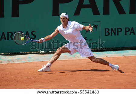 PARIS - MAY 20: Ramirez Hidalgo of Spain in action at French Open, Roland Garros qualification 2nd round match on May 20, 2010 in Paris, France. - stock photo