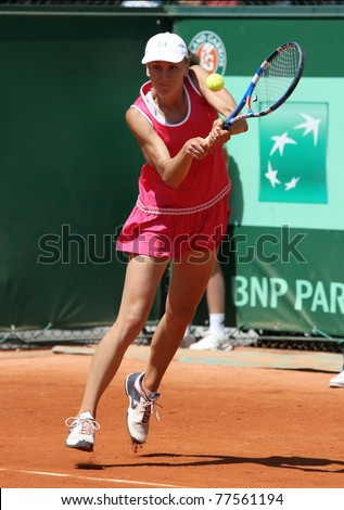 PARIS - MAY 19: Regina Kulikova of Russia plays the 2nd round qualification match at French Open, Roland Garros on May 19, 2011 in Paris, France.