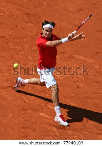 PARIS - MAY 23: Roger Federer of Switzerland plays the 1st round match at French Open, Roland Garros on May 23, 2011 in Paris, France. - stock photo