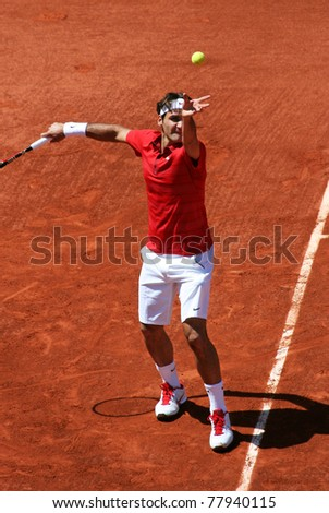 PARIS - MAY 23: Roger Federer of Switzerland serves during the 1st round match at French Open, Roland Garros on May 23, 2011 in Paris, France. - stock photo