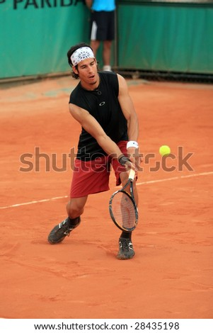 PARIS - MAY 23: Serbia's professional tennis player Ilia Bozoljac during the match at French Open, Roland Garros, May 23, 2008 in Paris, France. - stock photo