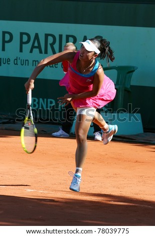 PARIS - MAY 23: Shuai Peng of China plays the 1st round match at French Open, Roland Garros on May 23, 2011 in Paris, France. - stock photo