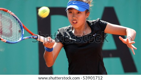 PARIS - MAY 20: Shuai ZHANG of China plays the 2nd round qualification match at French Open, Roland Garros on May 20, 2010 in Paris, France. - stock photo