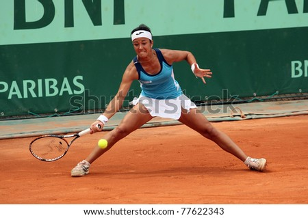 PARIS - MAY 20: Silvia Soler-Espinosa of Spain plays the 3rd round qualification match at French Open, Roland Garros on May 20, 2011 in Paris, France. - stock photo