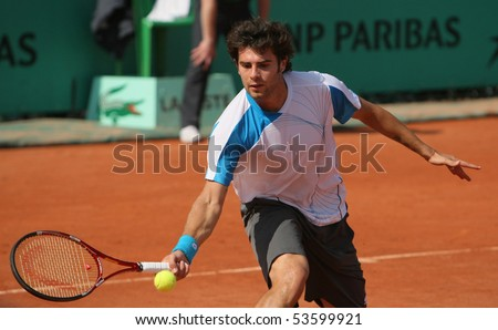 PARIS - MAY 21: Simone BOLELLI of Italy in action at French Open, Roland Garros qualification 3rd round match on May 21, 2010 in Paris, France. - stock photo
