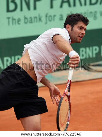 PARIS - MAY 20: Simone Bolelli of Italy plays the 3rd round qualification match  at French Open, Roland Garros on May 20, 2011 in Paris, France. - stock photo