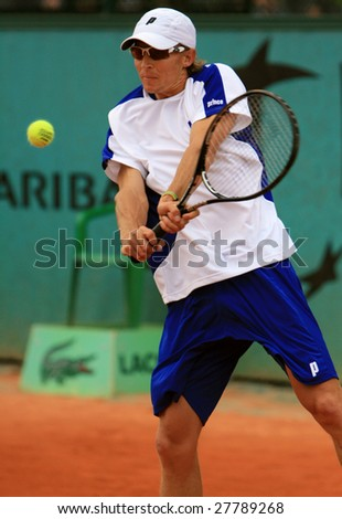 PARIS - MAY 22: South African tennis player Rik De Voest returns the ball during the match at French Open, Roland Garros on May 22, 2008 in Paris, France. - stock photo