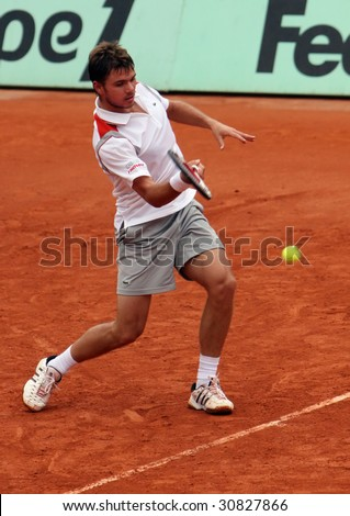 PARIS - MAY 23: Stanislas Wawrinka of Switzerland in action during the match at French Open, Roland Garros on May 23, 2009 in Paris, France. - stock photo