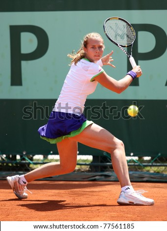 PARIS - MAY 19: Stefanie Voegele of Switzerland plays the 2nd round qualification match at French Open, Roland Garros on May 19, 2011 in Paris, France. - stock photo
