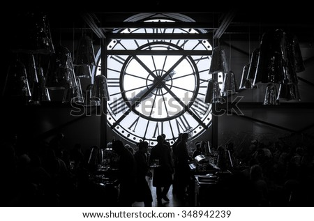 PARIS - MAY 11TH,2015: Silhouette photo of Cafe with famous ancient clock window in Orsay Museum is full with visitors in black and white, MAY 11, 2015 in Paris, France. - stock photo