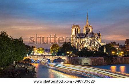PARIS - MAY 5TH,2015: The illuminated Notre Dame de Paris at night in on MAY 5TH,2015 in Paris, France. Notre Dame de Paris is the largest and most famous Gothic architecture in the world. - stock photo
