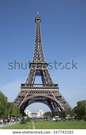 PARIS - MAY 3: The Eiffel Tower with blue sky on May 3, 2011 in Paris. The Eiffel tower is the most visited monument of France with about 6 million visitors every year.  - stock photo