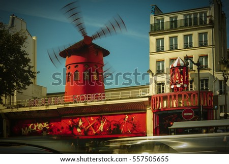 PARIS - May 20: The Moulin Rouge windmill, on May 20, 2016 in Paris, France. Moulin Rouge is a famous cabaret built in 1889, located in the Paris red-light district of Pigalle.