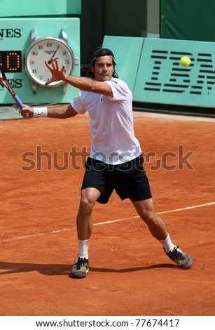 PARIS - MAY 21: Tommy Haas of Germany plays the exhibition match  at French Open, Roland Garros on May 21, 2011 in Paris, France. - stock photo