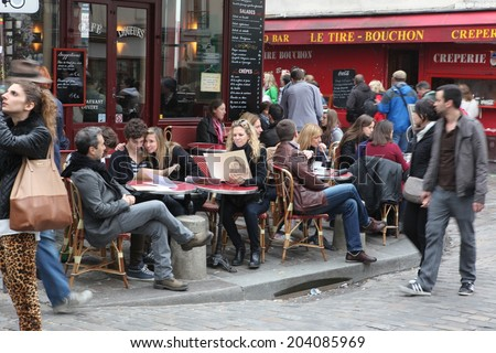 PARIS - MAY 1: Typical Montmartre Paris cafe on 2013. Montmartre area is among most popular destinations in Paris, many artists worked around the Montmartre such as Pablo Picasso or Vincent van Gogh - stock photo