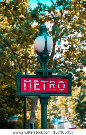 Paris metro sign on bright day - stock photo