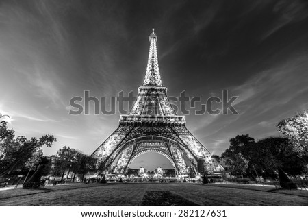 PARIS - NOV 1: A black and white photo of Eiffel Tower Light Performance Show in Dusk on November 1, 2014. The Eiffel tower is the most visited monument of France. - stock photo