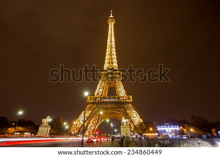 PARIS - NOV 23: Eiffel Tower Light Performance Show in Dusk on November 23, 2014. The Eiffel tower is the most visited monument of France. - stock photo