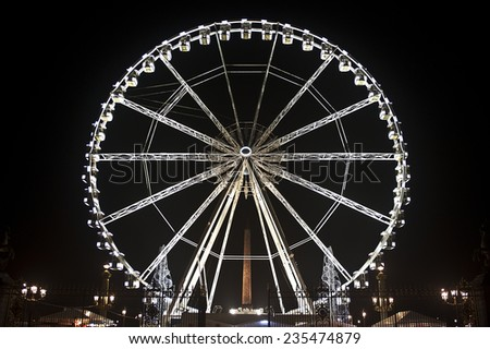 PARIS-NOV 21:Ferris Wheel illuminated at night on  November 21 in Paris, France  - stock photo