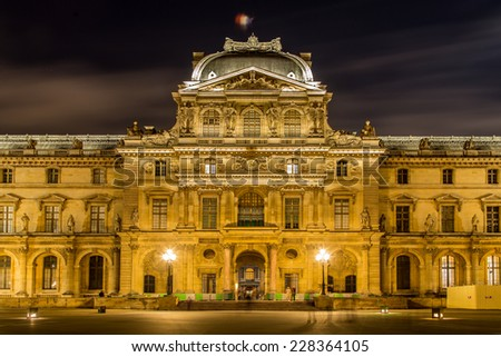 PARIS - NOV 1: Louvre Museum at twilight in autumn in November 1,2014. Louvre Museum is one of the world's largest museums with more than 8 million visitors each year. - stock photo