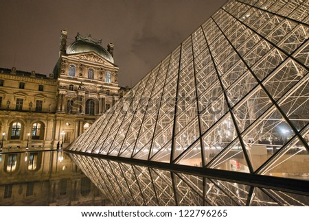PARIS - NOV 30: Louvre Pyramid shines at night with its modern structure, November 30, 2012 in Paris. Louvre is the biggest Museum in Paris displaying over 60,000 square meters of exhibition space