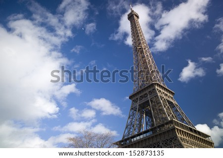 PARIS - NOV 30: The beautiful Eiffel Tower on November 30, 2012 in Paris, France. The Tower stands 324 metres (1,063 ft) tall. Monument was built in 1889, attendance is over 7 millions people. - stock photo